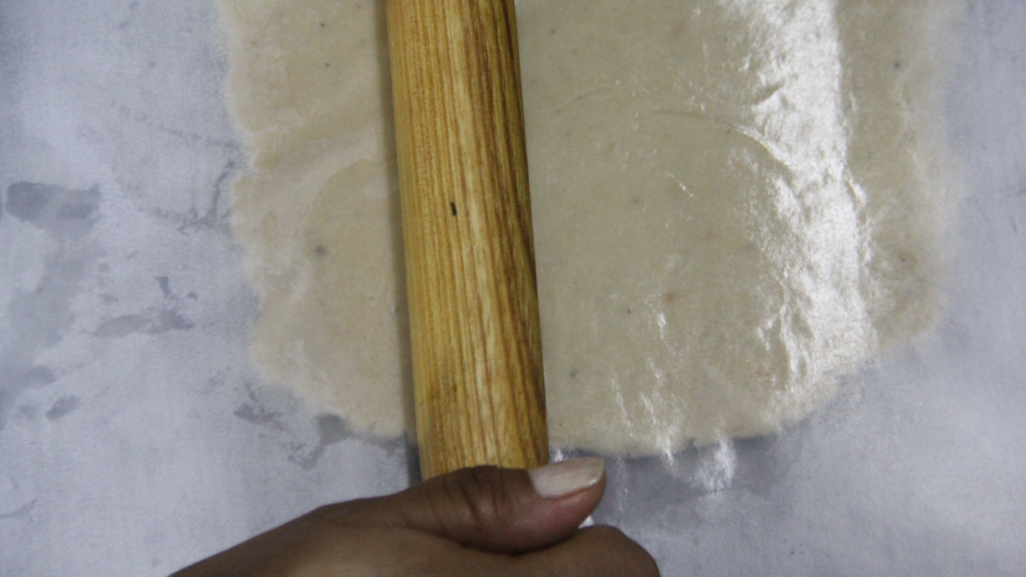Rolling Kaju dough for kaju katli